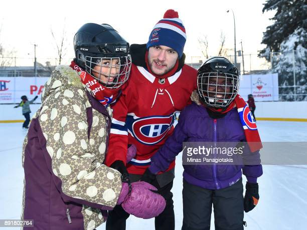 Jonathan Drouin of the Montreal Canadiens poses with children during the official inauguration of the Bleu Blanc Bouge rink by the Montreal Canadiens...