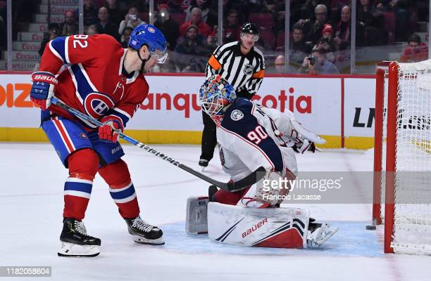 Jonathan Drouin of the Montreal Canadiens scores a goal during the shootout on goaltender Elvis Merzlikins of the Columbus Blue Jackets in the NHL...
