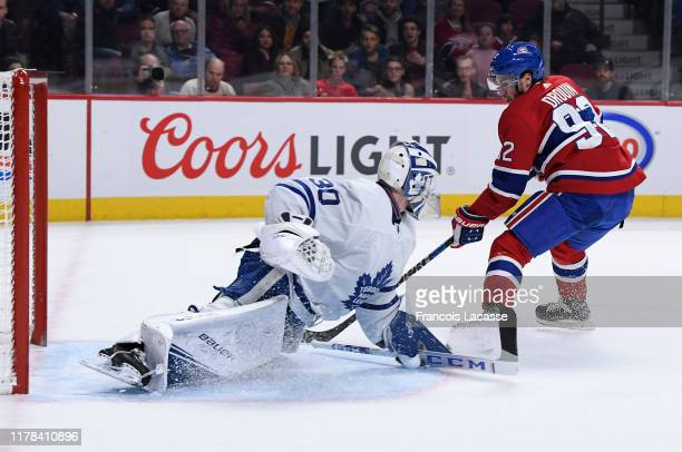 Jonathan Drouin of the Montreal Canadiens scores a shorthanded goal on goaltender Michael Hutchinson of the Toronto Maple Leafs in the NHL game at...
