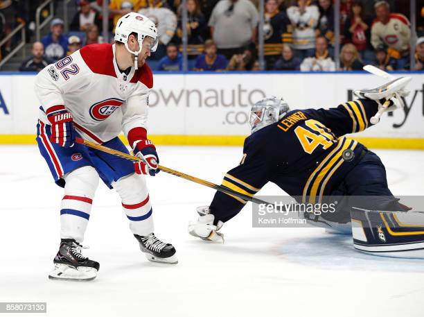 Jonathan Drouin of the Montreal Canadiens scores the winning goal against Robin Lehner of the Buffalo Sabres during the shootout at the KeyBank...