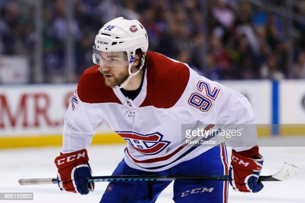 Jonathan Drouin of the Montreal Canadiens sets to take a face off against the Toronto Maple Leafs during the third period at the Air Canada Centre on...