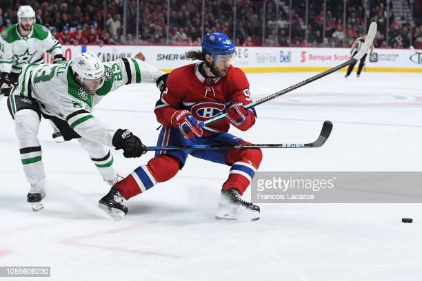Jonathan Drouin of the Montreal Canadiens skates for the puck while being challenged by Esa Lindell of the Dallas Stars in the NHL game at the Bell...