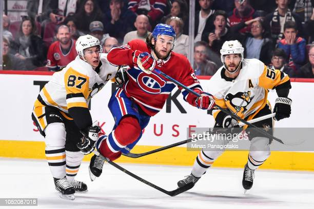 Jonathan Drouin of the Montreal Canadiens skates through Sidney Crosby and Kris Letang of the Pittsburgh Penguins during the NHL game at the Bell...