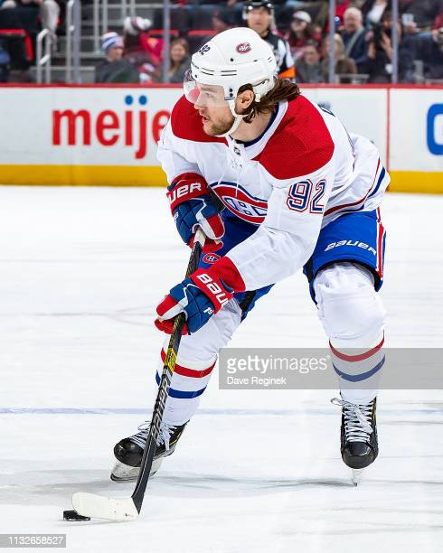 Jonathan Drouin of the Montreal Canadiens skates up ice with the puck against the Detroit Red Wings during an NHL game at Little Caesars Arena on...