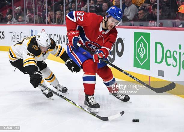 Jonathan Drouin of the Montreal Canadiens tries to keep the puck from Torey Krug of the Boston Bruins in the NHL game at the Bell Centre on January...