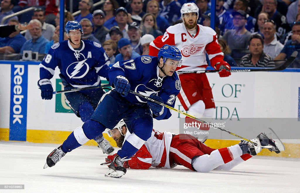 Jonathan Drouin #27 of the Tampa Bay Lightning avoids a check by the Detroit Red Wings during the second period in Game One of the Eastern Conference Quarterfinals during the 2016 NHL Stanley Cup Playoffs at Amalie Arena on April 13, 2016 in Tampa, Florida.