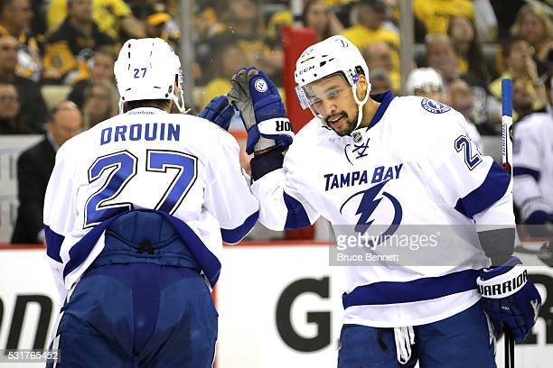 Jonathan Drouin of the Tampa Bay Lightning celebrates with his teammate JT Brown after scoring a goal against Matt Murray of the Pittsburgh Penguins...