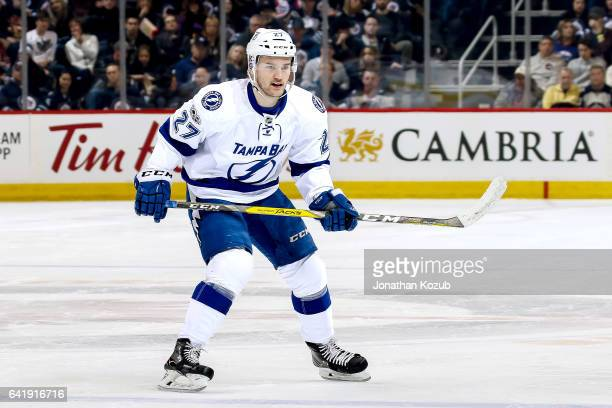 Jonathan Drouin of the Tampa Bay Lightning keeps an eye on the play during first period action against the Winnipeg Jets at the MTS Centre on...