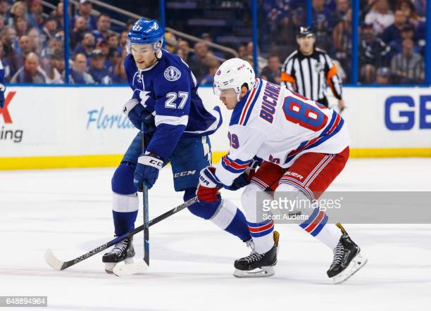 Jonathan Drouin of the Tampa Bay Lightning skates against Pavel Buchnevich of the New York Rangers during the third period at Amalie Arena on March 6...