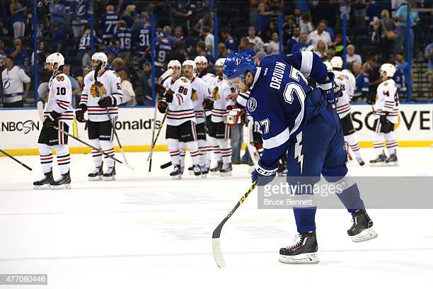 Jonathan Drouin of the Tampa Bay Lightning skates off the ice as the Chicago Blackhawks celebrate defeating Tampa Bay Lightning 2 to 1 during Game...