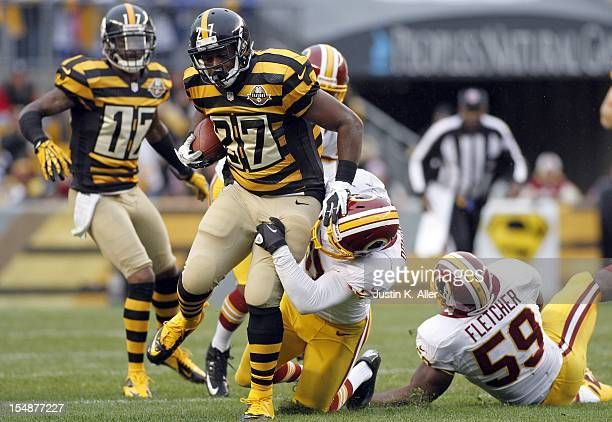 Jonathan Dwyer of the Pittsburgh Steelers carries the ball against Reed Doughty of the Washington Redskins during the game on October 28 2012 at...