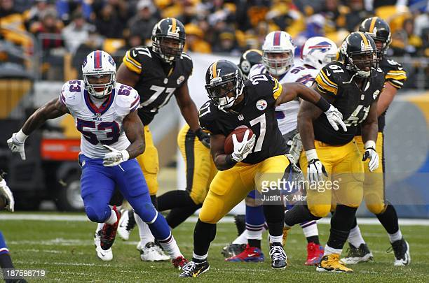 Jonathan Dwyer of the Pittsburgh Steelers rushes against the Buffalo Bills during the game on November 10 2013 at Heinz Field in Pittsburgh...