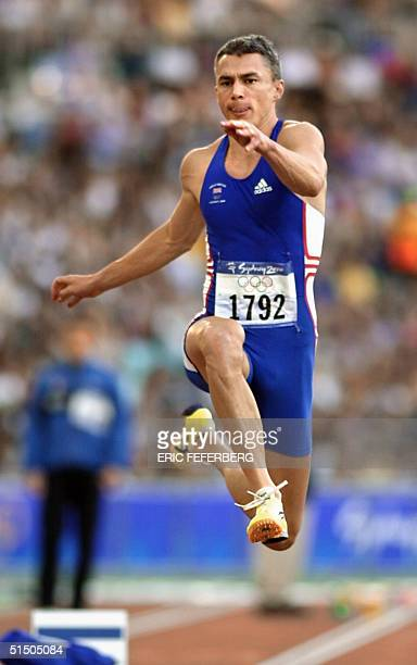Jonathan Edwards of Great Britain competes in Group A of the men's triple jump qualifying round 23 September, 2000 at the Sydney Olympic Games. AFP...