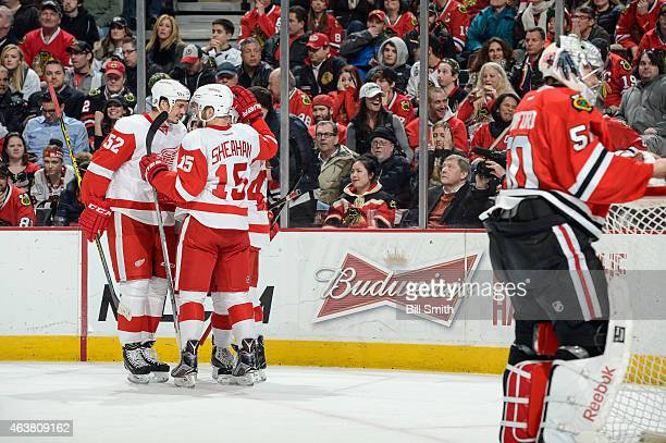 Jonathan Ericsson and Riley Sheahan of the Detroit Red Wings celebrate after the Red Wings scored on goalie Corey Crawford of the Chicago Blackhawks...