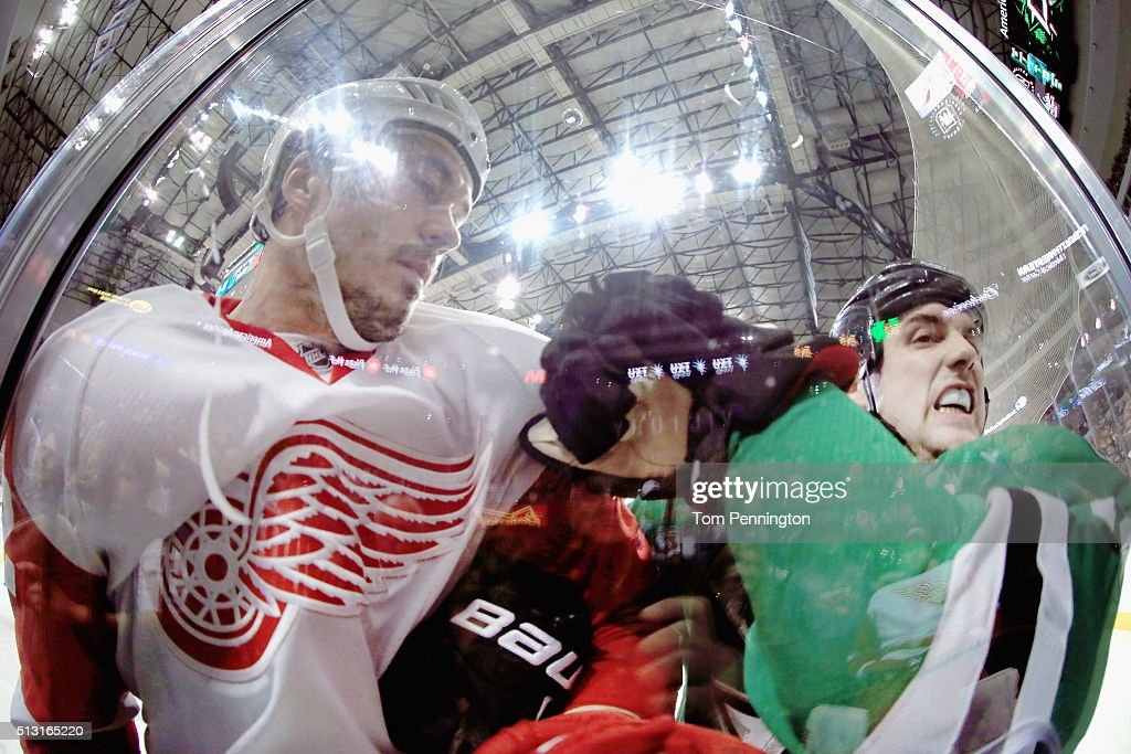 Jonathan Ericsson #52 of the Detroit Red Wings checks Jamie Benn #14 of the Dallas Stars into the glass in the second period at American Airlines Center on February 29, 2016 in Dallas, Texas.