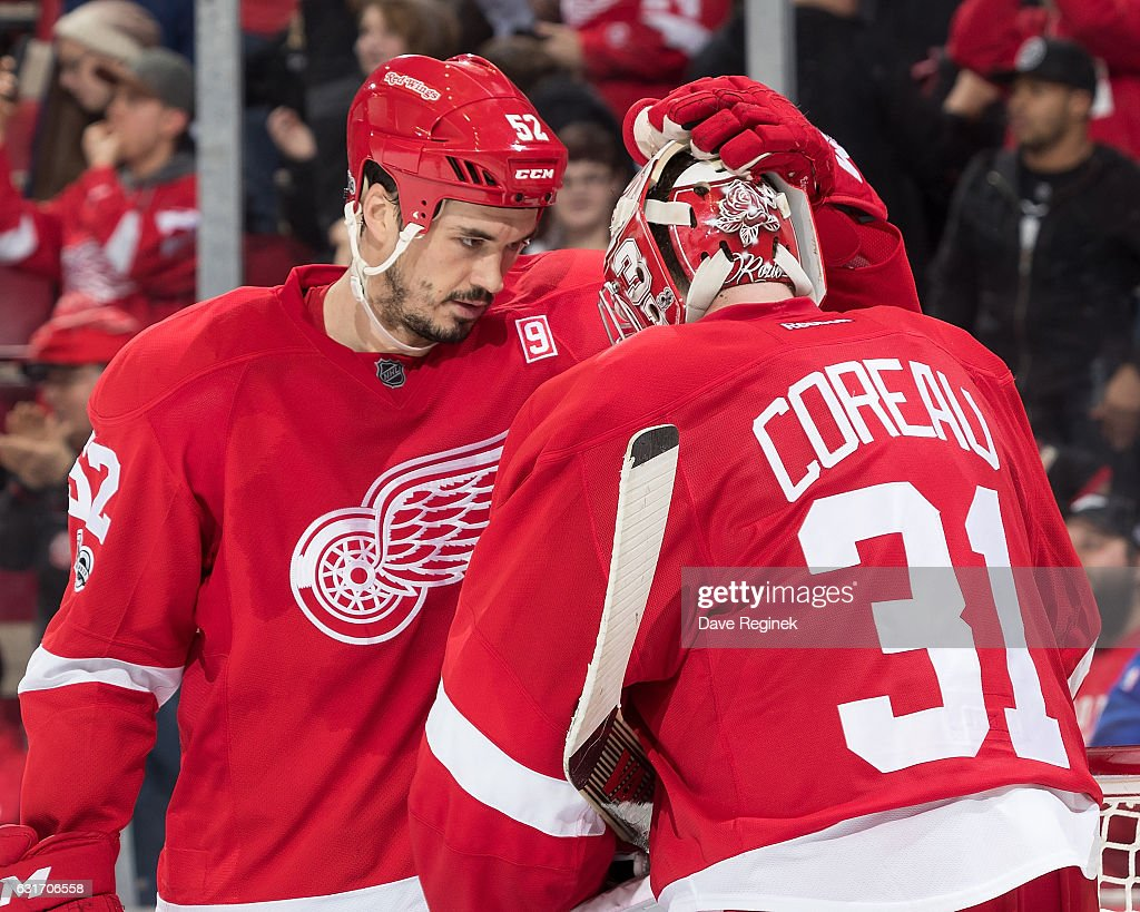 Jonathan Ericsson #52 of the Detroit Red Wings congratulates teammate goaltender Jared Coreau #31 on the win tonight following an NHL game against the Pittsburgh Penguins at Joe Louis Arena on January 14, 2017 in Detroit, Michigan. The Wings defeated the Penguins 6-3.