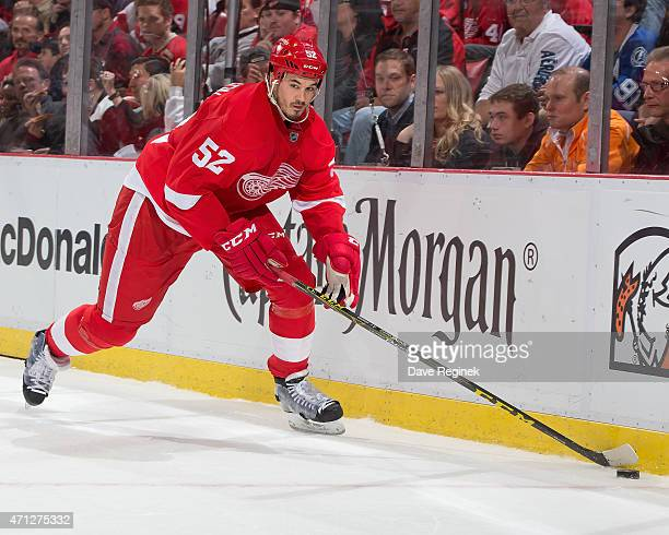 Jonathan Ericsson of the Detroit Red Wings controls the puck in the corner in Game Four of the Eastern Conference Quarterfinals against the Tampa Bay...