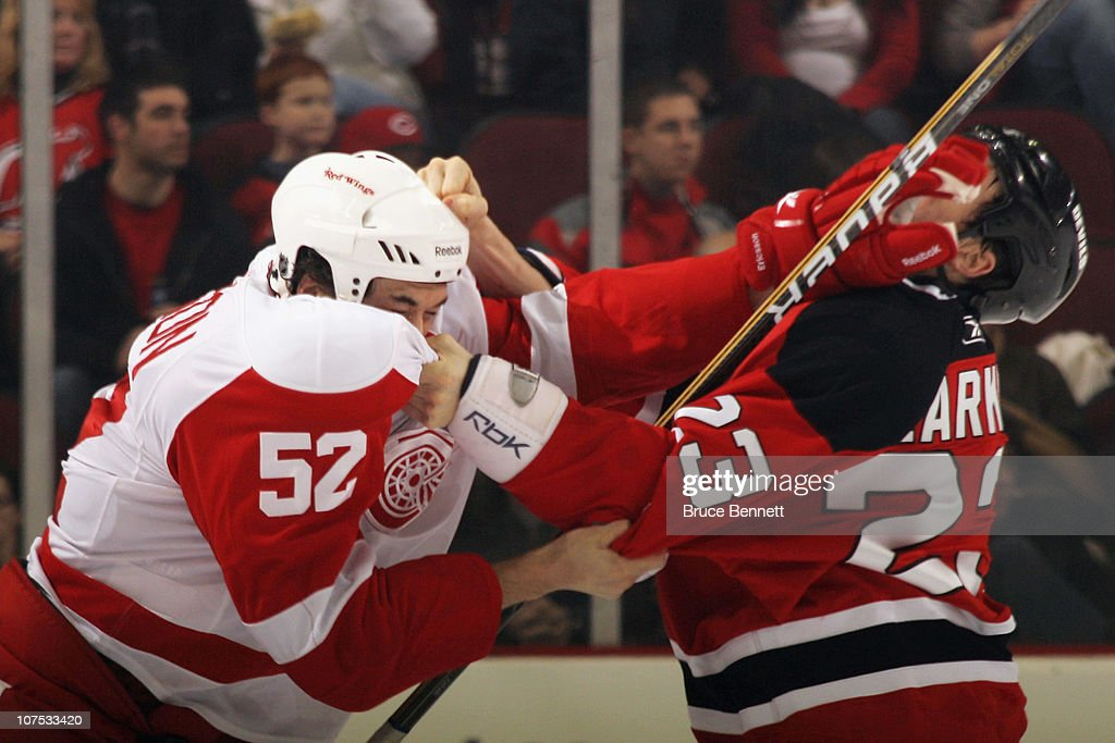 Jonathan Ericsson #52 of the Detroit Red Wings mixes it up with David Clarkson #23 of the New Jersey Devils at the Prudential Center on December 11, 2010 in Newark, New Jersey.