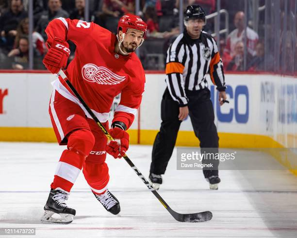 Jonathan Ericsson of the Detroit Red Wings shoots the puck against the Tampa Bay Lightning during an NHL game at Little Caesars Arena on March 8,...
