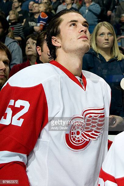 Jonathan Ericsson of the Detroit Red Wings stands for the national anthems before a game against the Edmonton Oilers at Rexall Place on March 19 2010...