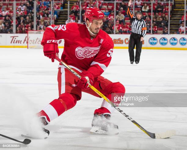 Jonathan Ericsson of the Detroit Red Wings stops with the puck during an NHL game against the New Jersey Devils at Joe Louis Arena on January 31 2017...