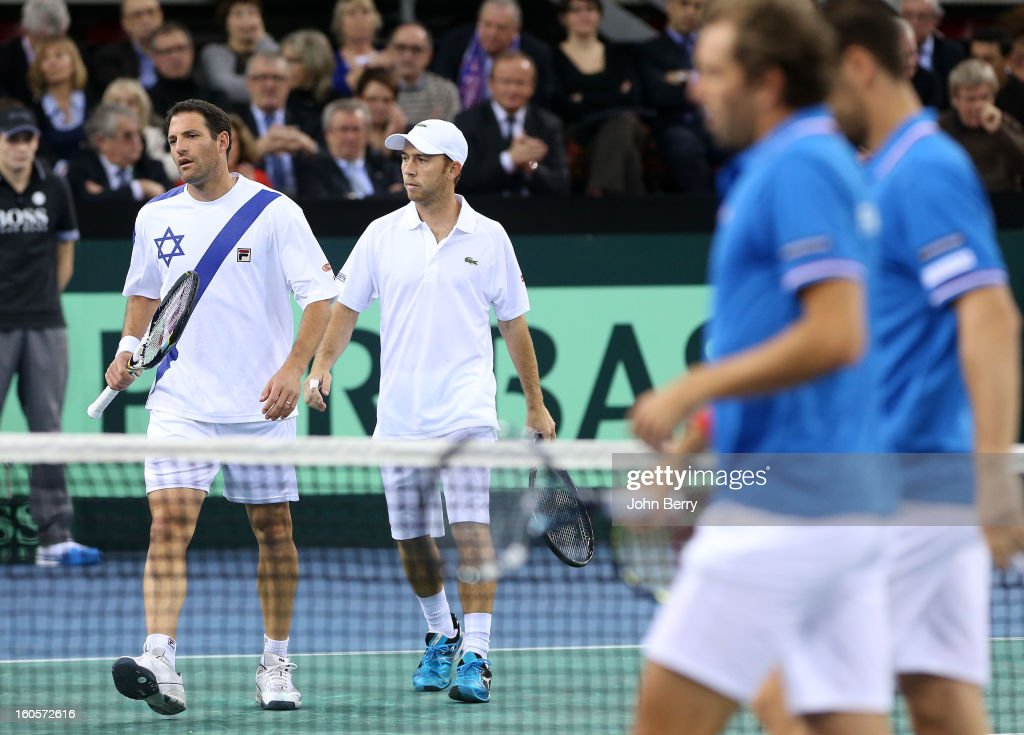 Jonathan Erlich (L) and Dudi Sela of Israel during their doubles match against Julien Bennetteau and Michael Llodra of France on day two of the Davis Cup first round match between France and Israel at the Kindarena stadium on February 2, 2013 in Rouen, France.