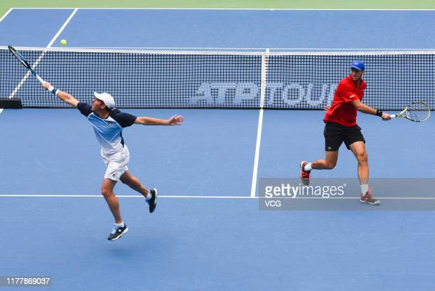 Jonathan Erlich of Israel and Fabrice Martin of France compete in the Men's Doubles final match against Dusan Lajovic of Serbia and Nikola Cacic of...