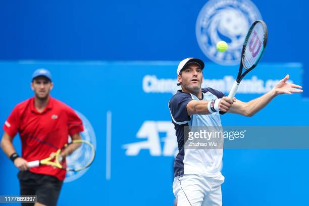 Jonathan Erlich of Israel and Fabrice Martin of France in action against Nikola Cacic and Dusan Lajovic of Serbia during ATP World Tour Chengdu Open...