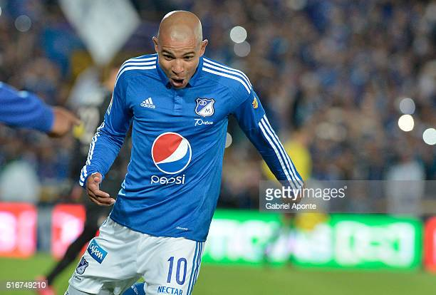 Jonathan Estrada of Millonarios celebrates after scoring the second goal of his team during a match between Millonaris and Santa Fe as part of 10th...