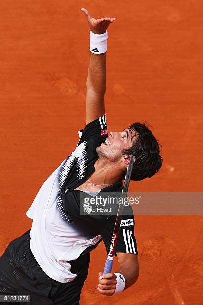 Jonathan Eysseric of France serves during the Men's Singles first round match against Andy Murray of Great Britain on day one of the French Open at...