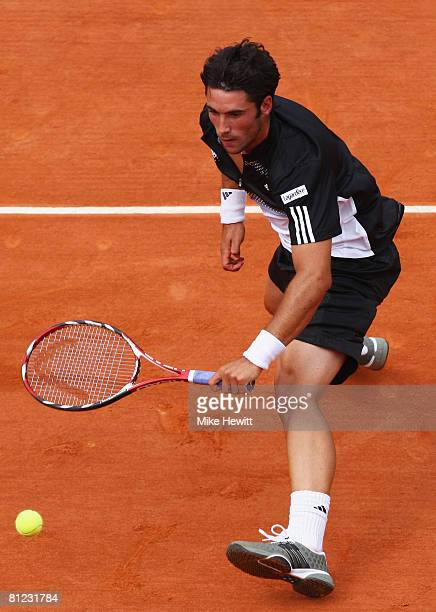 Jonathan Eysseric of France stretches for the ball during the Men's Singles first round match against Andy Murray of Great Britain on day one of the...
