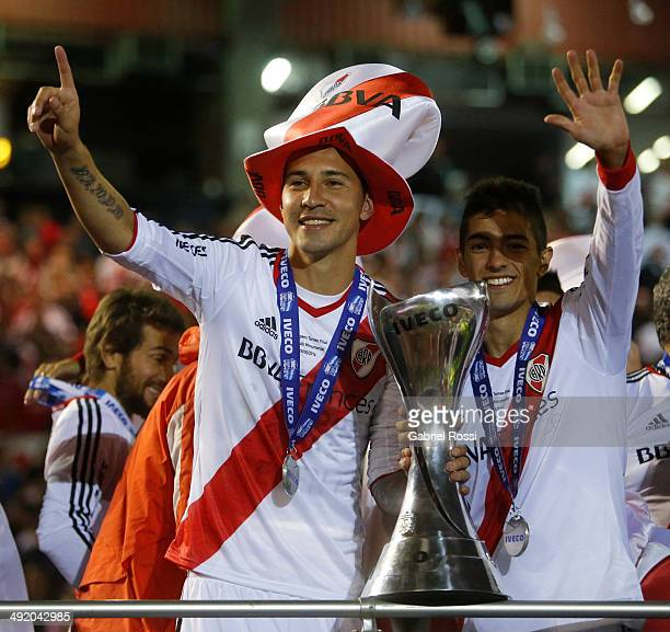 Jonathan Fabbro and Manuel Lanzini of River Plate celebrate at the end of Torneo Final 2014 after winning the match between River Plate and Quilmes...