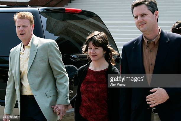 Jonathan Falwell Jeannie Falwell Savas and Jerry Falwell Jr walk toward the media for an interview after a viewing of their late father the Rev Jerry...