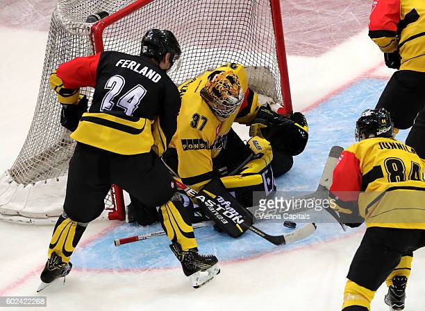 Jonathan Ferland of Vienna Capitals and Eero Kilpelainen of KalPa Kuopio during the Champions Hockey League match between Vienna Capitals and KalPa...