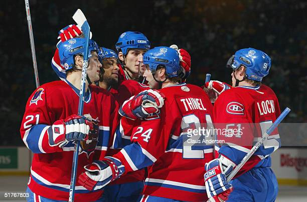 Jonathan Ferland, Trevor Daley, Ron Hainsey, Marc-Andre thinel and Corey Locke of the Hamilton Bulldogs celebrate during the game against the...
