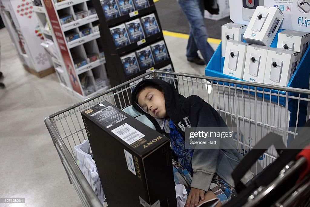 Jonathan Fernandez, 6, sleeps in his parents shopping cart after entering a Best Buy store at dawn on Black Friday, the day after Thanksgiving which commences the holiday gift-buying season on November 26, 2010 in Naples, Florida. Hundreds of shoppers spent the night camped in front of the store to be the first ones in when doors opened at 5am. Black Friday typically features steep discounts on such favorite items as toys and electronics.