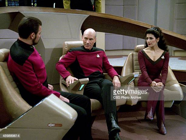Jonathan Frakes as Commander William T. Riker, Patrick Stewart as Captain Jean-Luc Picard and Marina Sirtis as Counselor Deanna Troi in the STAR...