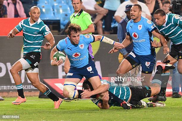 Jonathan Francke of the Griquas tackles Burger Odendaal of the Vodacom Blue Bulls during the Currie Cup match between Vodacom Blue Bulls and Griquas...