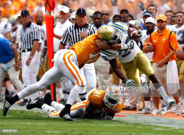Jonathan Franklin of the UCLA Bruins is knocked out of bounds by Janzen Jackson of the Tennessee Volunteers on September 12 2009 at Neyland Stadium...