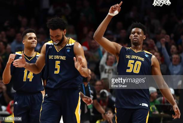 Jonathan Galloway and Evan Leonard and Elston Jones of the UC Irvine Anteaters celebrate a 7064 win against the Kansas State Wildcats for their first...
