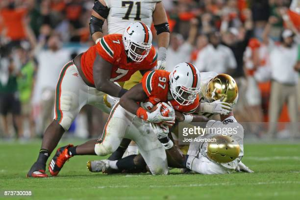 Jonathan Garvin of the Miami Hurricanes recovers the fumble by Brandon Wimbush of the Notre Dame Fighting Irish during fourth quarter action on...