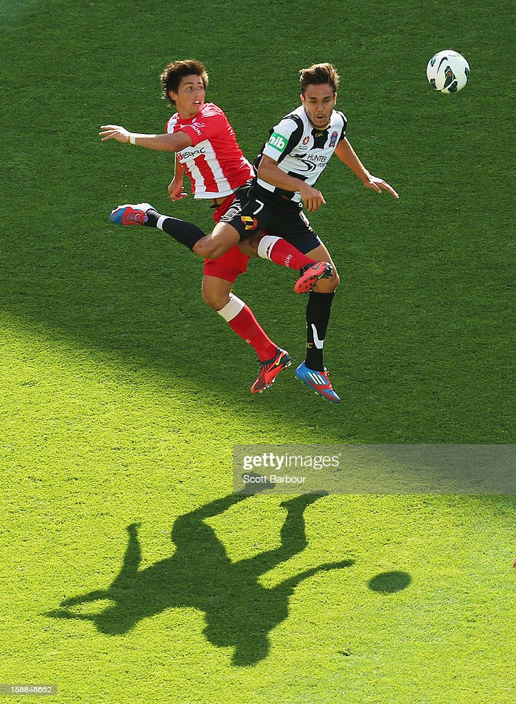 Jonathan Germano of the Heart and James Brown of the Jets compete for the ball during the round 14 A-League match between Melbourne Heart and the Newcastle Jets at AAMI Park on January 1, 2013 in Melbourne, Australia.