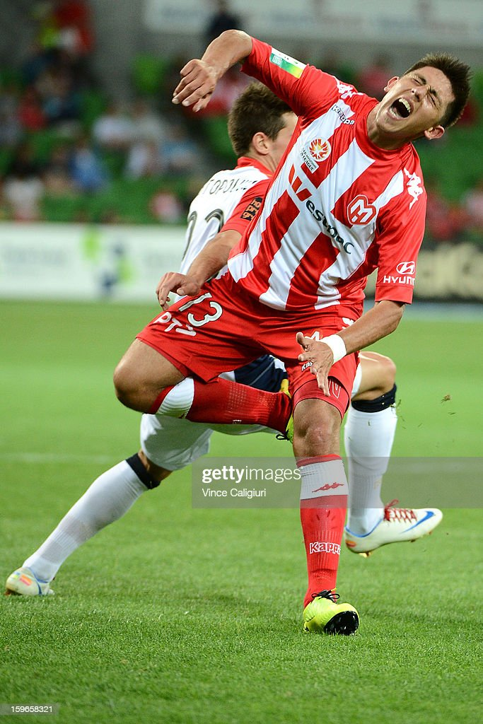 Jonathan Germano of the Heart is tackled by Evan Kostopoulos of United during the round seventeen A-League match between Melbourne Heart and Adelaide United at AAMI Park on January 18, 2013 in Melbourne, Australia.