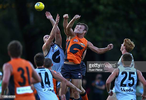 Jonathan Giles and Dean Brogan of the Giants compete for the ball during the Greater Western Sydney Giants Intra-Club AFL match at Lakeside Oval on...