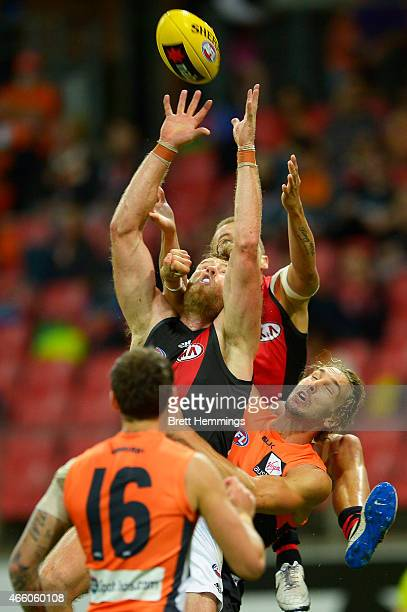Jonathan Giles of the Bombers leaps for a high ball during the NAB Challenge AFL match between the Greater Western Sydney Giants and the Essendon...