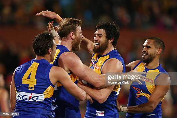 Jonathan Giles of the Eagles is congratulated by teammates after he kicked a goal during the round 23 AFL match between the Adelaide Crows and the...