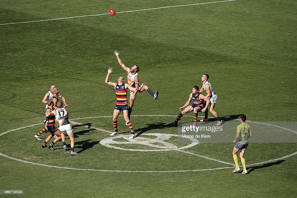 Jonathan Giles of the Giants competes in the ruck with Sam Jacobs of the Crows during the round five AFL match between the Adelaide Crows and the Greater Western Sydney Giants at Adelaide Oval on April 20, 2014 in Adelaide, Australia.