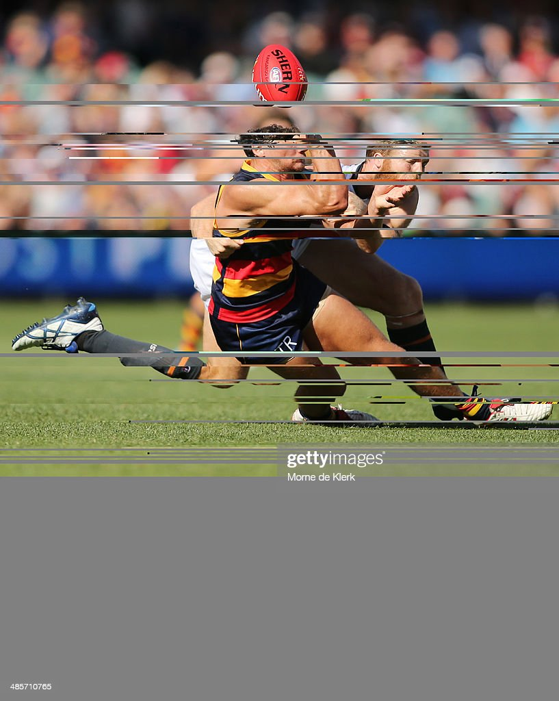 Jonathan Giles of the Giants tackles Kyle Hartigan of the Crows during the round five AFL match between the Adelaide Crows and the Greater Western Sydney Giants at Adelaide Oval on April 20, 2014 in Adelaide, Australia.