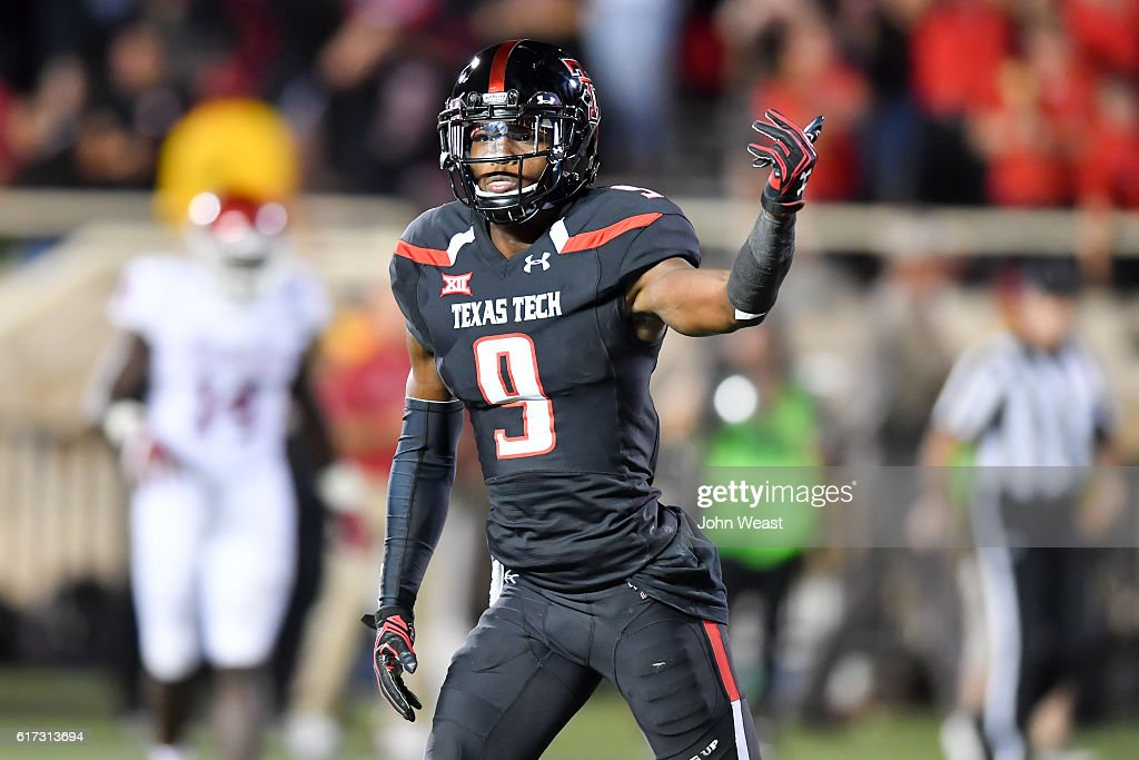 Jonathan Giles #9 of the Texas Tech Red Raiders reacts to scoring a touchdown during the game between the Texas Tech Red Raiders and the Oklahoma Sooners on October 22, 2016 at AT&T Jones Stadium in Lubbock, Texas. Oklahoma won the game 66-59.