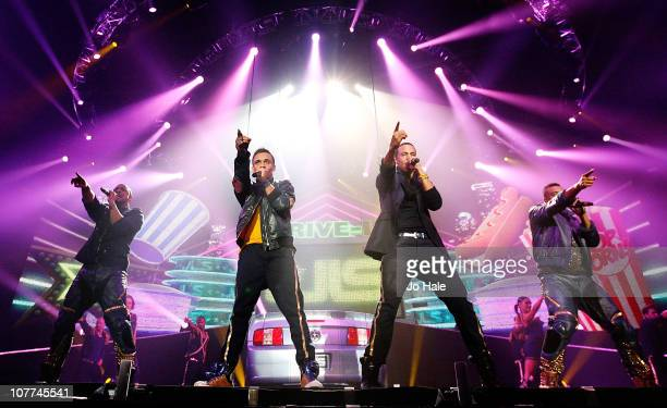 Jonathan Gill Aston Merrygold Marvin Humes and Oritse Williams of JLS perform at Wembley Arena on December 22 2010 in London England